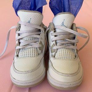 White/gray Jordan's Nike. Toddler size 5